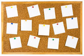 Cork board with pinned white notes — Stock Photo