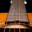 Classical guitar close up on dark — ストック写真