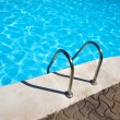 Stock Photo: Ladder to swimming pool