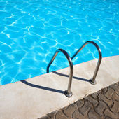Ladder to swimming pool — Stock Photo