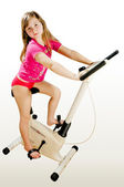 The girl on a velosimulator — Stock Photo