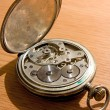 Stock Photo: Close-up of old clock on vintage backgr