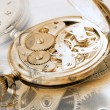 Foto Stock: Close-up of old clock on vintage backgro