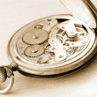Stock Photo: Close-up of old clock on vintage backgro