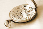 Close-up of old clock on vintage backgro — Stock Photo