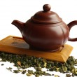 Stock Photo: clay teapot for the chinese tea on the w