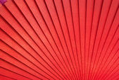 Chinese red wooden fan on the white — Stock Photo