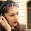 Young woman speaking a mobile phone — Stock Photo