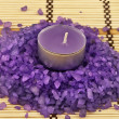 Heap of violet bath salt wiih candle — Stock Photo #1845981
