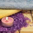Heap of violet bath salt wiih candle — Stock Photo