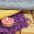 Heap of violet bath salt wiih candle — Stock Photo #1877602