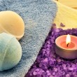 Violet  salt with candle — Stock Photo