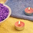 Heap of violet bath salt wiih candles — Stock Photo