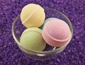 Violet salt and bath balls — Stock Photo