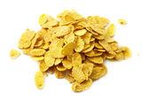 Heap of corn flakes on the white — Stock Photo