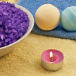 Violet  salt with candle and bath balls — Stock Photo