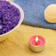 Violet  salt with candle and bath ball — Stock Photo