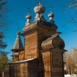Wooden orthodox church in wood — Stock Photo
