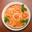 Tasty Italian pizza with lemon — Stock Photo