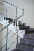 Enclosure with metallic stair railing — Stock Photo