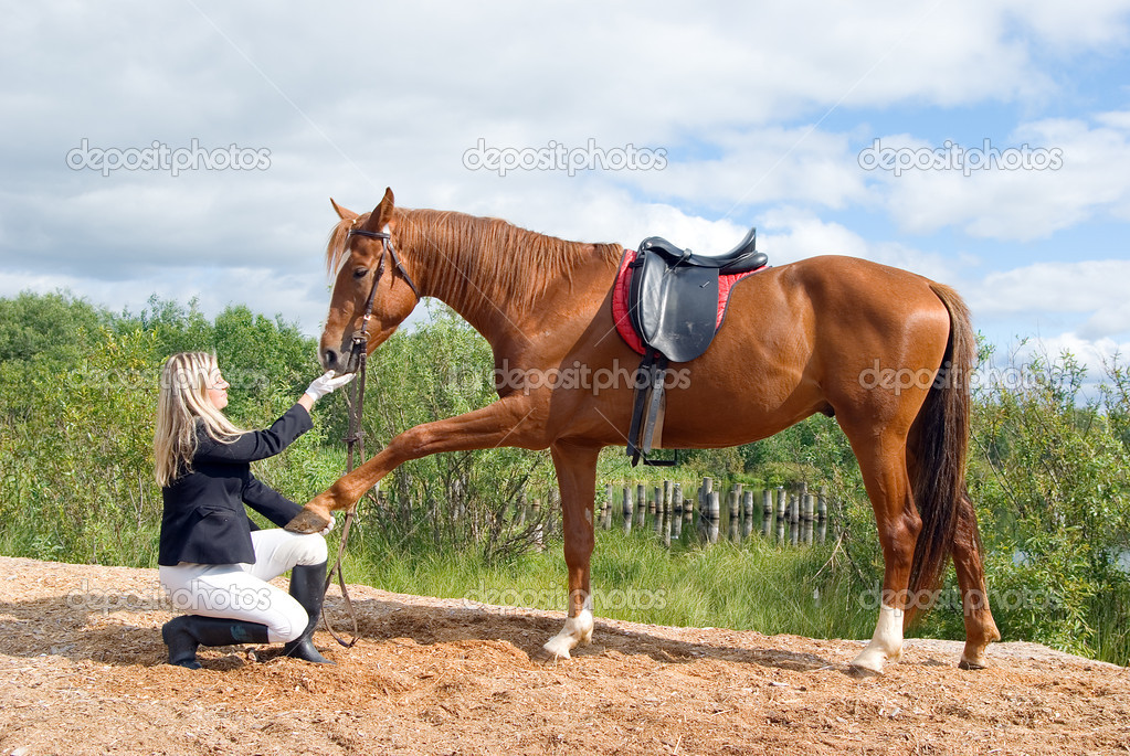 Girl with horse.Friendship of an animal and the person — Stock Photo #1123794