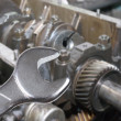 Car engine and spanner. Focus on spanner - Stock Photo