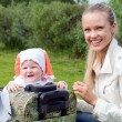 Girl and child in valise. — Stock Photo