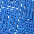 Background of blue plastic dowels — Stock Photo #1113899