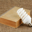 Power saving up bulb and book — Stock Photo #1124552