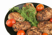 Meat cutlets and red tomatoes — Stock Photo
