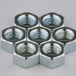 Seven metal nuts — Stock Photo #1155682