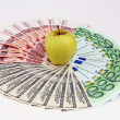 Royalty-Free Stock Photo: Yellow apple and denominations