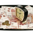 Stok fotoğraf: Old alarm clock and new money