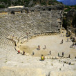 Ancient amphitheatre with walking — Stock Photo