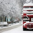 Red double-decker in winter - Stock Photo