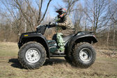The man goes on ATV in the spring — Stock Photo