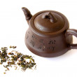 Chinese clay teapot with tea leaves - Stock Photo