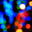 Christmas colored glowing blur lights - Stock Photo