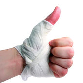 Bandaged hand brush — Stock Photo