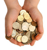 Coins in the children — Stock Photo