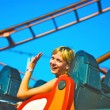 Girl riding on a roller coaster — Stockfoto