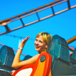 Girl riding on a roller coaster - Stock Photo