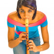 Stock Photo: Playing flute