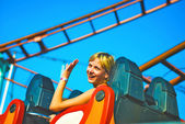Girl riding on a roller coaster — Stock Photo
