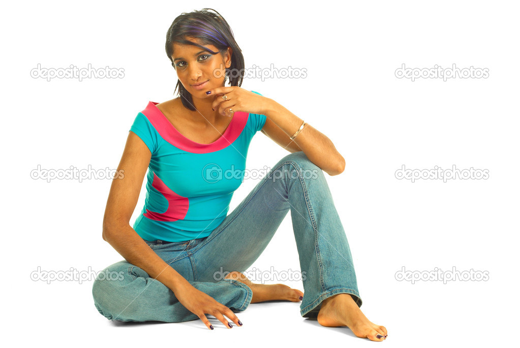 Beautiful brown woman sitting on the floor isolated over white  Stock Photo #1101502