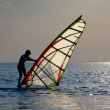 A women is learning windsurfing at the s — Stock Photo