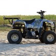 Small All Terrain Vehicle on a beach - Stock Photo