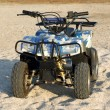 Small All Terrain Vehicle on a beach 2 - Stock Photo