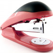 Red stapler on a white background. isola — Stock Photo #1104311