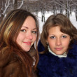 Portrait of two girls in the winter in p — Stock Photo